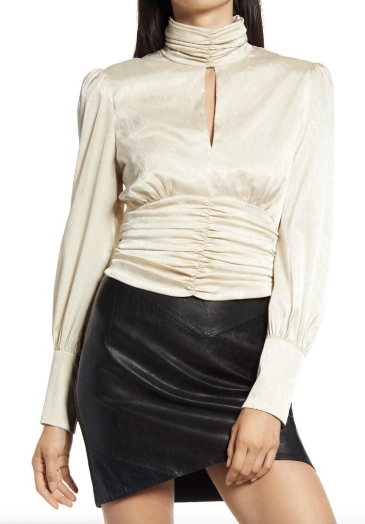 <p>This <span>WAYF Holly Mock Neck Satin Jacquard Top</span> ($43, originally $78) is so festive and stylish. </p>