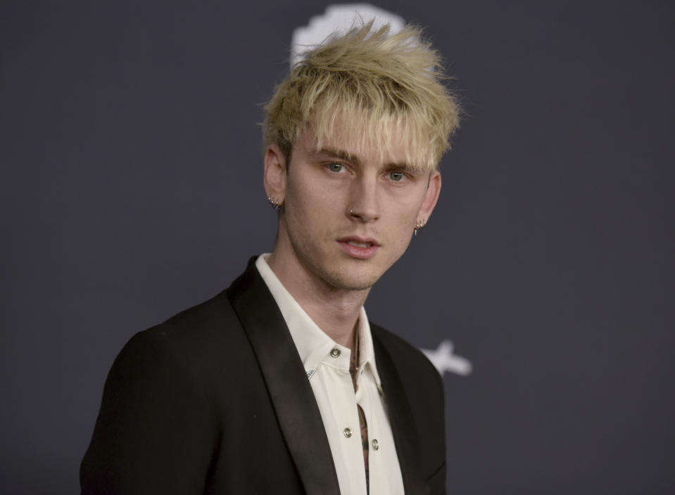 Machine Gun Kelly arrives at the InStyle and Warner Bros. Golden Globes afterparty at the Beverly Hilton Hotel on Sunday, Jan. 5, 2020, in Beverly Hills, Calif. (Richard Shotwell/Invision/AP)