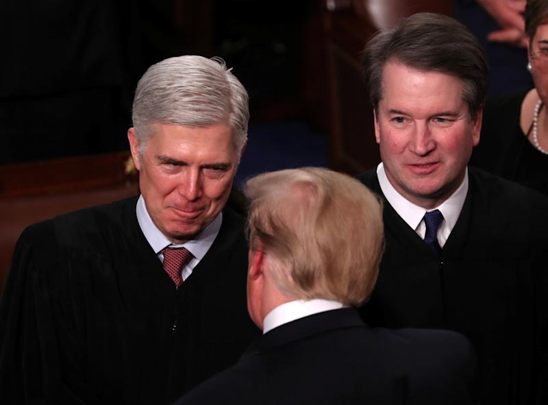 President Donald Trump talks with Supreme Court Justice Neil Gorsuch (L) and Justice Brett Kavanaugh on Capitol Hill in February. (Photo: Jonathan Ernst / Reuters)