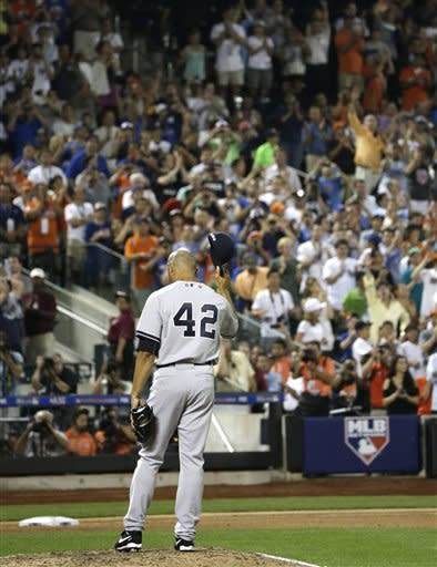 American League's Mariano Rivera, of the New York Yankees, acknowledges a standing ovation during the eighth inning of the MLB All-Star baseball game, on Tuesday, July 16, 2013, in New York. (AP Photo/Matt Slocum)