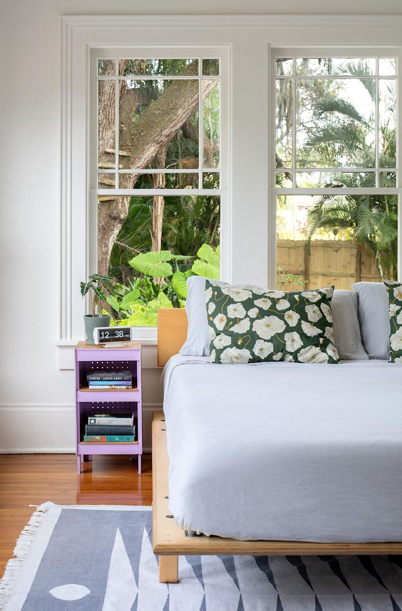 In the master bedroom, the simple platform bed is Modernica's Case Study Bentwood Bed and the geometric patterned rug is from Block Shop Textiles.
