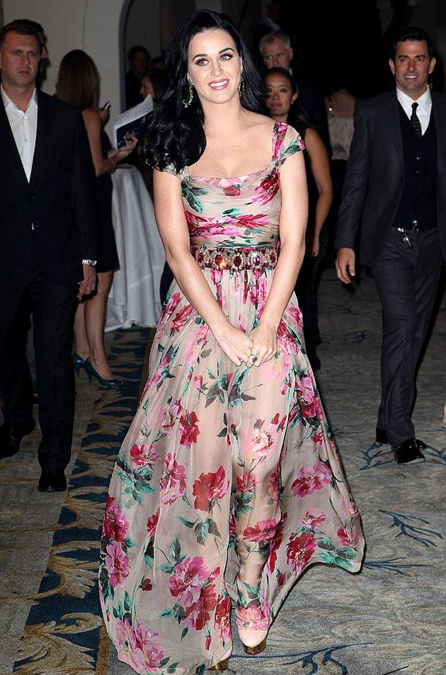 Katy Perry has a style all her own – bright, bold, and over the top. So this floral Dolce & Gabbana dress, which the singer wore to the Dream Foundation Celebration of Dreams, was like a breath of fresh spring air! While flowery frocks can tend to be a tad boring (remember the Gunne Sax trend in the '80s?), the pop star's gown had a lot of flair – from the gemmed belt to the sheer skirt. Bringing together the whole look was Perry's minimal makeup. In this case, less was certainly more! (11/16/2012)