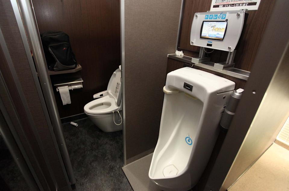 """A urinal that has a video game console above it in the SEGA World complex in Akihabara Electric Town, Tokyo, Japan. For men a stroll to the gents has become a leap into the twenty first century, thanks to the SEGA video games corporation. The company has developed a new entertainment system which is incorporated into a public lavatory. Now rows of peeing men can spend a penny and get a great video game experience while they are at it. The """"Toylet"""" male urinal video game provides a choice of sumo wrestling, erasing graffiti and dousing an exploding volcano. The """"Toylet"""" works by a pressure sensor in the base of the urinal measuring the strength and location of the urine stream as it hits the basin. An LCD screen displays the game graphics and rewards the strength, length and accuracy of the pee through a typical video game points system. There are currently no plans for a multiplayer version of the """"Toylet"""". (Photo by Matthew Tabaccos / Barcroft Medi / Getty Images)"""