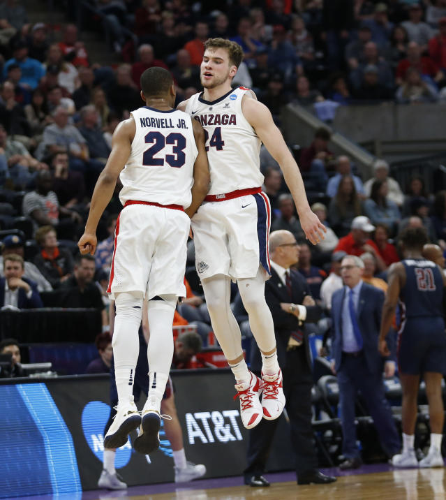Gonzaga's Corey Kispert (24) celebrates with Zach Norvell Jr. (23) after scoring against Fairleigh Dickinson during the first half of a first-round game in the NCAA mens college basketball tournament Thursday, March 21, 2019, in Salt Lake City. (AP Photo/Rick Bowmer)