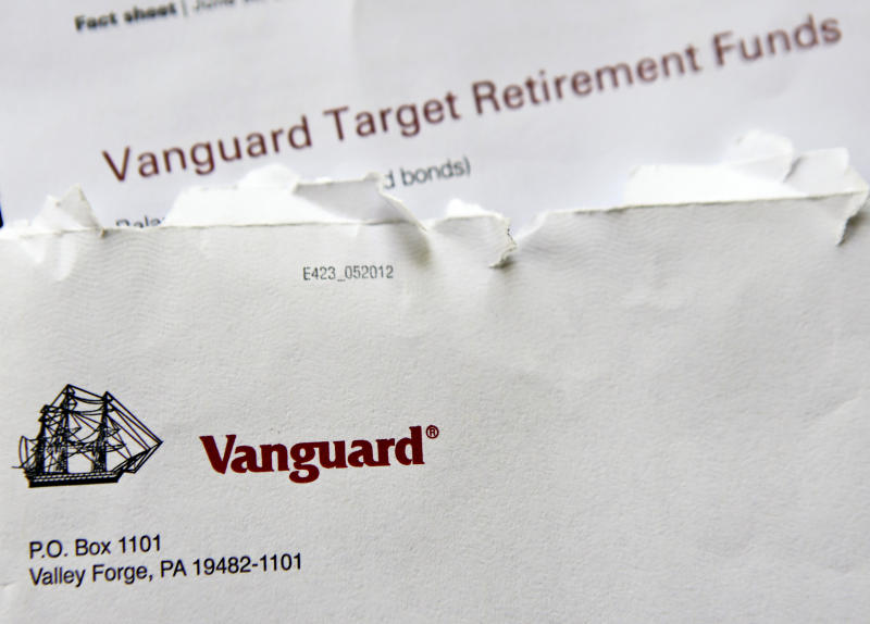 In this June 7, 2018, photo the logo for the Vanguard Group is shown on correspondence in Zelienople, Pa. Vanguard said Monday, July 2, that it will stop charging commissions to trade most of its competitors' exchange-traded funds. (AP Photo/Keith Srakocic)
