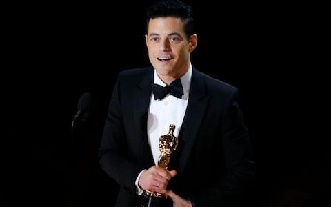 Rami Malek accepting the Best Actor award for his role in Bohemian Rhapsody - Credit: MIKE BLAKE/REUTERS
