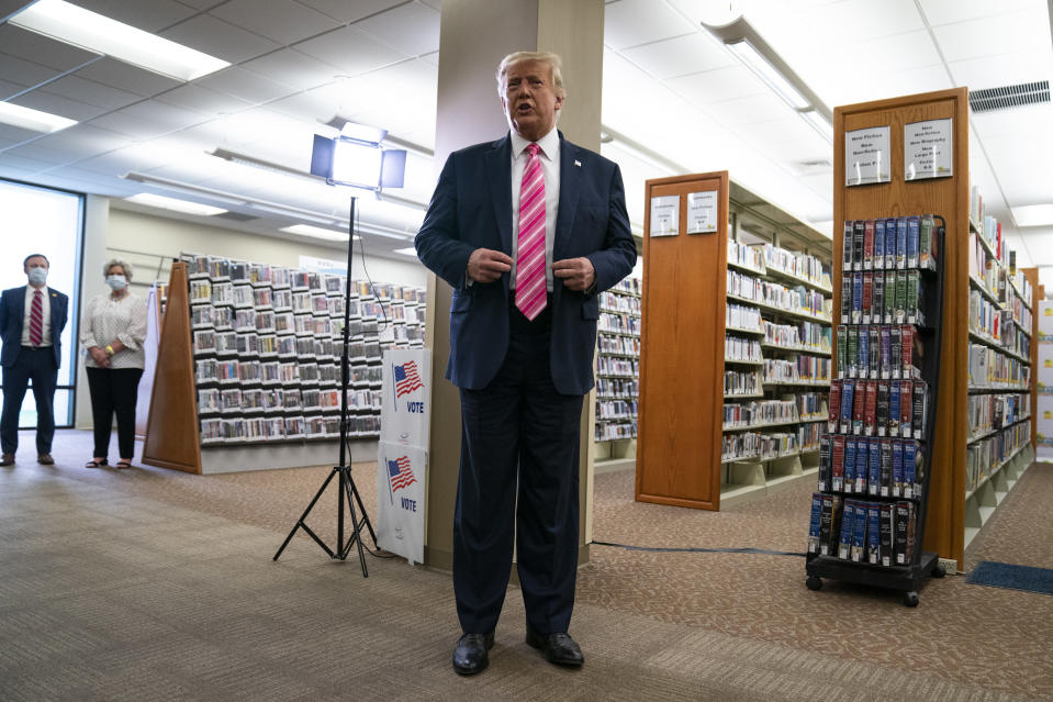 President Donald Trump talks with reporters after casting his ballot in the presidential election, Saturday, Oct. 24, 2020, in West Palm Beach, Fla. (AP Photo/Evan Vucci)