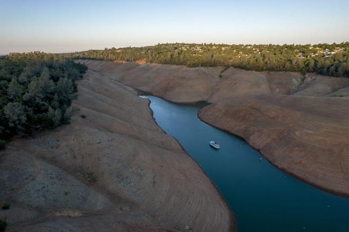 """<div class=""""inline-image__title"""">1233610870</div> <div class=""""inline-image__caption""""><p>""""Steep banks surround a boat as it travels on Oroville Lake during low water levels in Oroville, California, U.S., on Tuesday, June 22, 2021. Almost three-fourths of the western U.S. is gripped by drought so severe that its off the charts of anything recorded in the 20-year history of the U.S. Drought Monitor. Photographer: Kyle Grillot/Bloomberg via Getty Images""""</p></div> <div class=""""inline-image__credit"""">Bloomberg</div>"""
