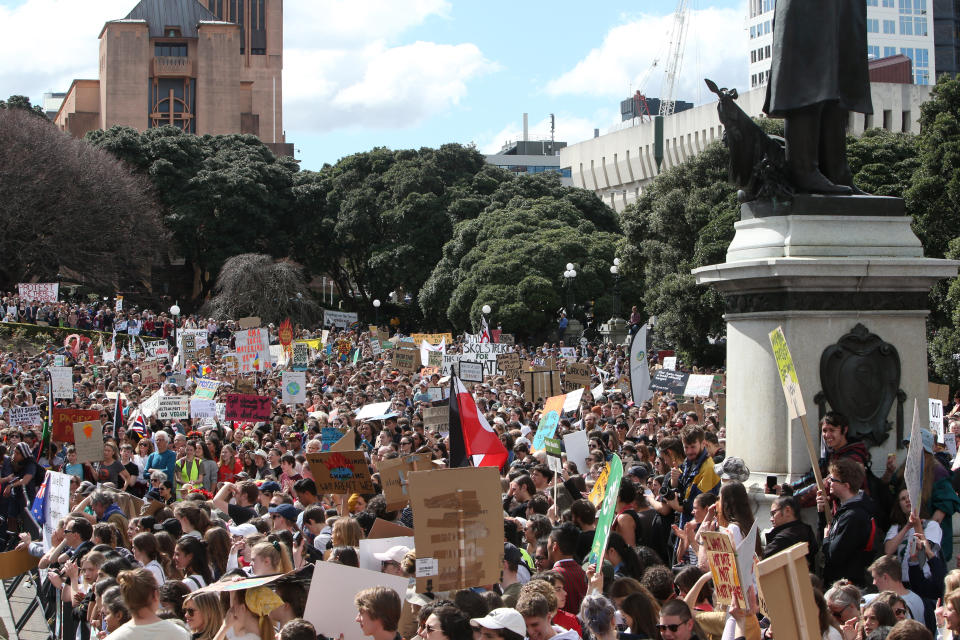 Thousands of people gather near Parliament to protest climate change in Wellington, New Zealand, Friday, Sept. 27, 2019. The protest in New Zealand was part of a second wave of protests around the world as the United Nations General Assembly met in New York. (AP Photo/Nick Perry)