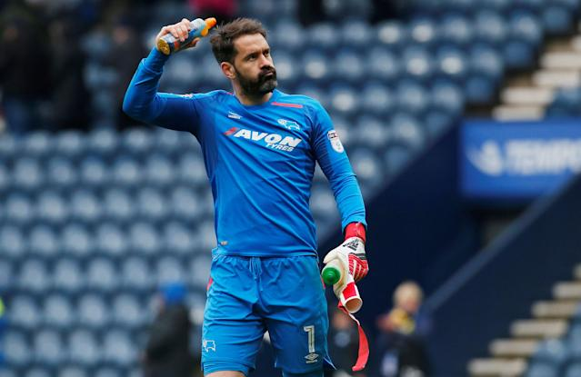"Soccer Football - Championship - Preston North End vs Derby County - Deepdale, Preston, Britain - April 2, 2018 Derby County's Scott Carson celebrates after the match Action Images/Craig Brough EDITORIAL USE ONLY. No use with unauthorized audio, video, data, fixture lists, club/league logos or ""live"" services. Online in-match use limited to 75 images, no video emulation. No use in betting, games or single club/league/player publications. Please contact your account representative for further details."