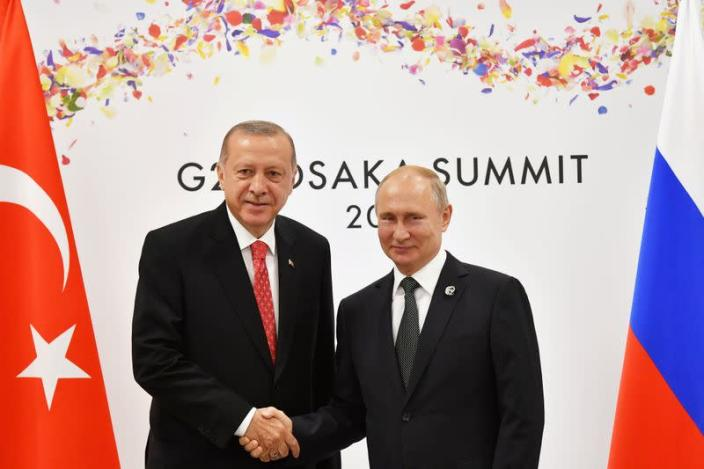FILE PHOTO: Russian President Putin and Turkish President Erdogan attend their bilateral meeting on the sidelines of the G20 leaders summit in Osaka