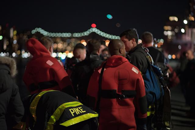 <p>New York cost guard boats conduct a search and rescue operation after a helicopter crashed into New York City's East River on March 12, 2018. (Photo: Michael Potash/Anadolu Agency/Getty Images) </p>