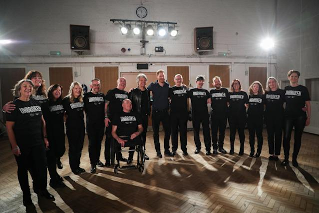 Harry met the choir members during the recording session. (Getty Images)