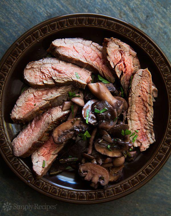 "<strong>Get the <a href=""http://www.simplyrecipes.com/recipes/grilled_flank_steak_with_mushrooms/"" target=""_blank"">Grilled Flank Steak With Mushrooms recipe</a> from Simply Recipes</strong>"