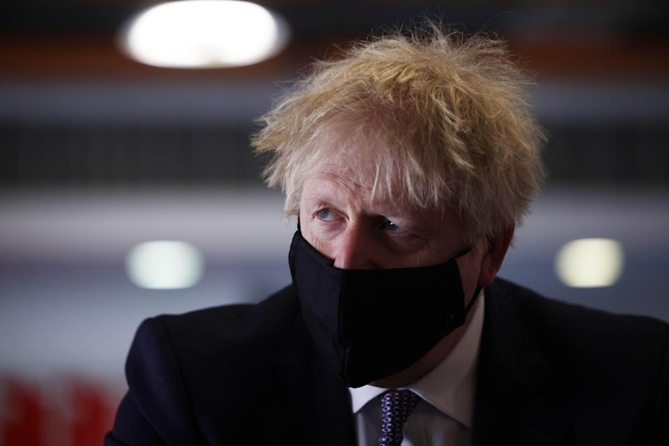 <p>A tired-looking Boris Johnson speaks with pupils after taking part in a science lesson at King Solomon Academy in Marylebone</p> (Getty Images)