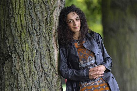 Masih Alinejad, 37, a Britain-based Iranian journalist, poses for a portrait in London October 8, 2013. REUTERS/Toby Melville