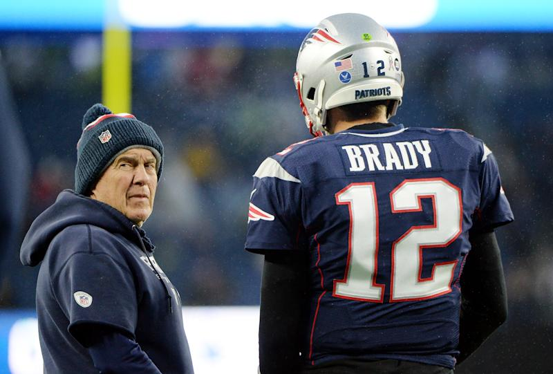 Bill Belichick talks with Tom Brady during a Patriots game.