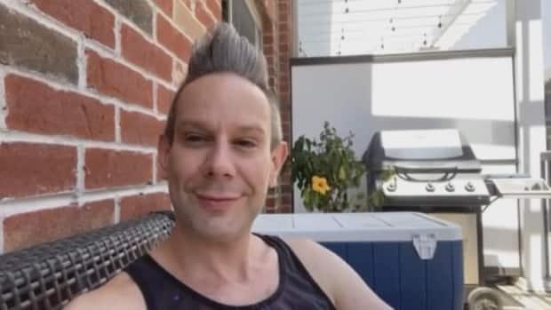 James Insell, who goes by the stage name Jimbo, is happy to see the LGBTQ+ community flooded with messages of support after T.Bear's Creamery in Windsor, Ont., refused to make a custom cake with the drag queen's face on it. (Jacob Barker/CBC - image credit)