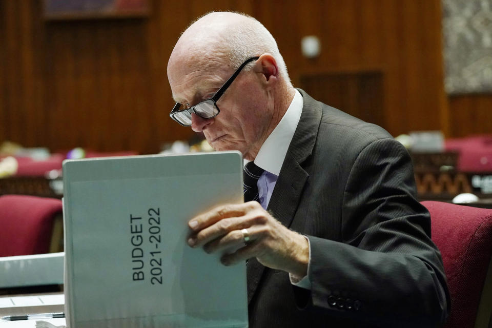 Arizona House Speaker Rusty Bowers, R-Mesa, looks over the printed budget prior to a vote on the Arizona budget at the Arizona Capitol Thursday, June 24, 2021, in Phoenix. (AP Photo/Ross D. Franklin)
