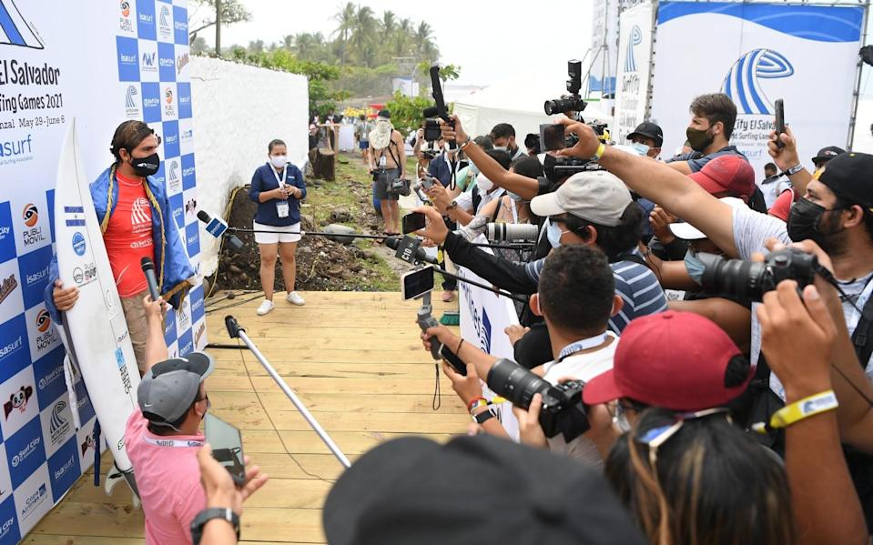 Bryan Perez answers questions from the media at the ISA World Surfing Games in El Salvador.