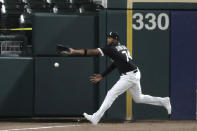 Chicago White Sox left fielder Eloy Jimenez can't make the play on an inside-the-park home run by Milwaukee Brewers' Christian Yelich during the fifth inning of a baseball game in Chicago, Thursday, Aug. 6, 2020. (AP Photo/Nam Y. Huh)