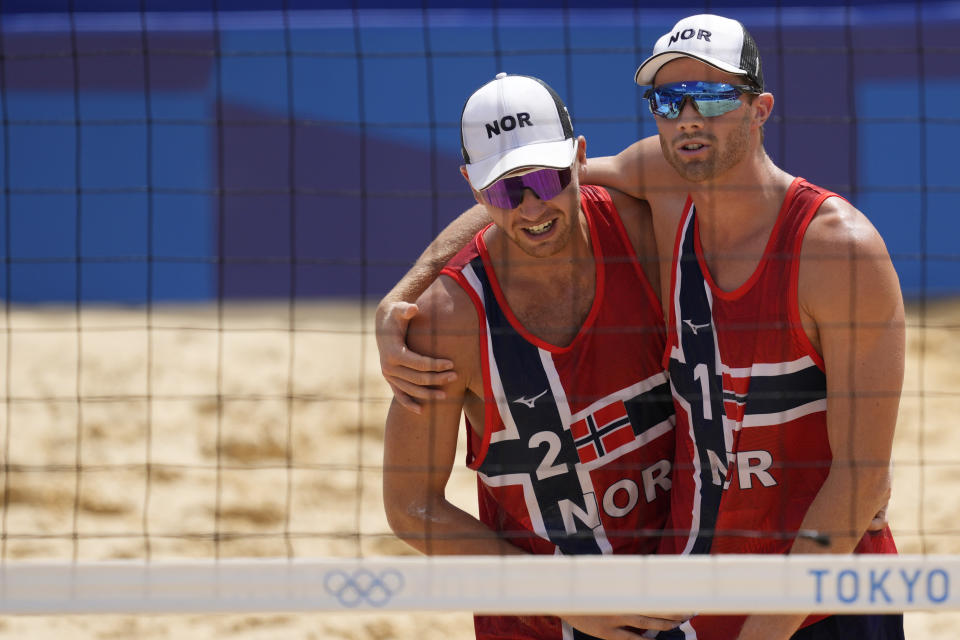 Anders Bernsten Mol, right, of Norway, and teammate Christian Sandle Sorum celebrate winning a men's beach volleyball quarterfinal match against the Russian Olympic Committee at the 2020 Summer Olympics, Wednesday, Aug. 4, 2021, in Tokyo, Japan. (AP Photo/Petros Giannakouris)