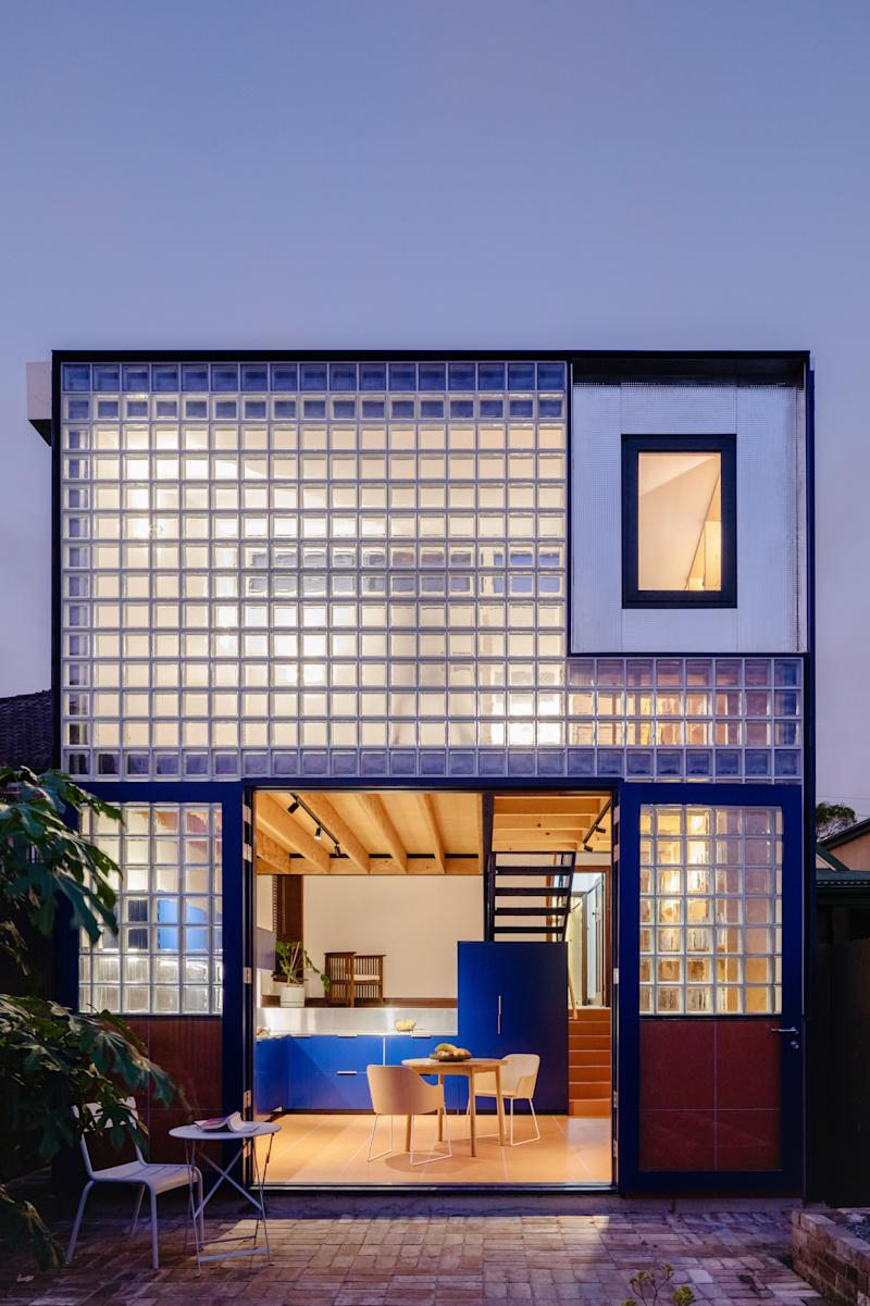 The back of the home looks completely opposite from the front, and is illuminated from all angles at night. A stainless-steel window in the corner can reflect the sky during the day.