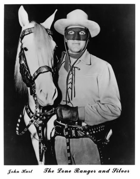 """This undated publicity still, circa early 1950s, provided by the Buffalo Bill Center of the West in Cody, Wyo., shows actor John Hart, who starred in the original """"The Lone Ranger"""" television series, which ran from 1952-1954 and horse Silver. The Colt .45 single-action revolver he used is seen holstered. The museum has acquired the pistol made famous by the masked hero of television from more than 60 years ago. The revolver is now on display at the Buffalo Bill Center of the West, in Cody. Hart used several firearms over his acting career, but this gun is special. It features ivory grips and intricate engraving. (AP Photo/Buffalo Bill Center of the West)"""