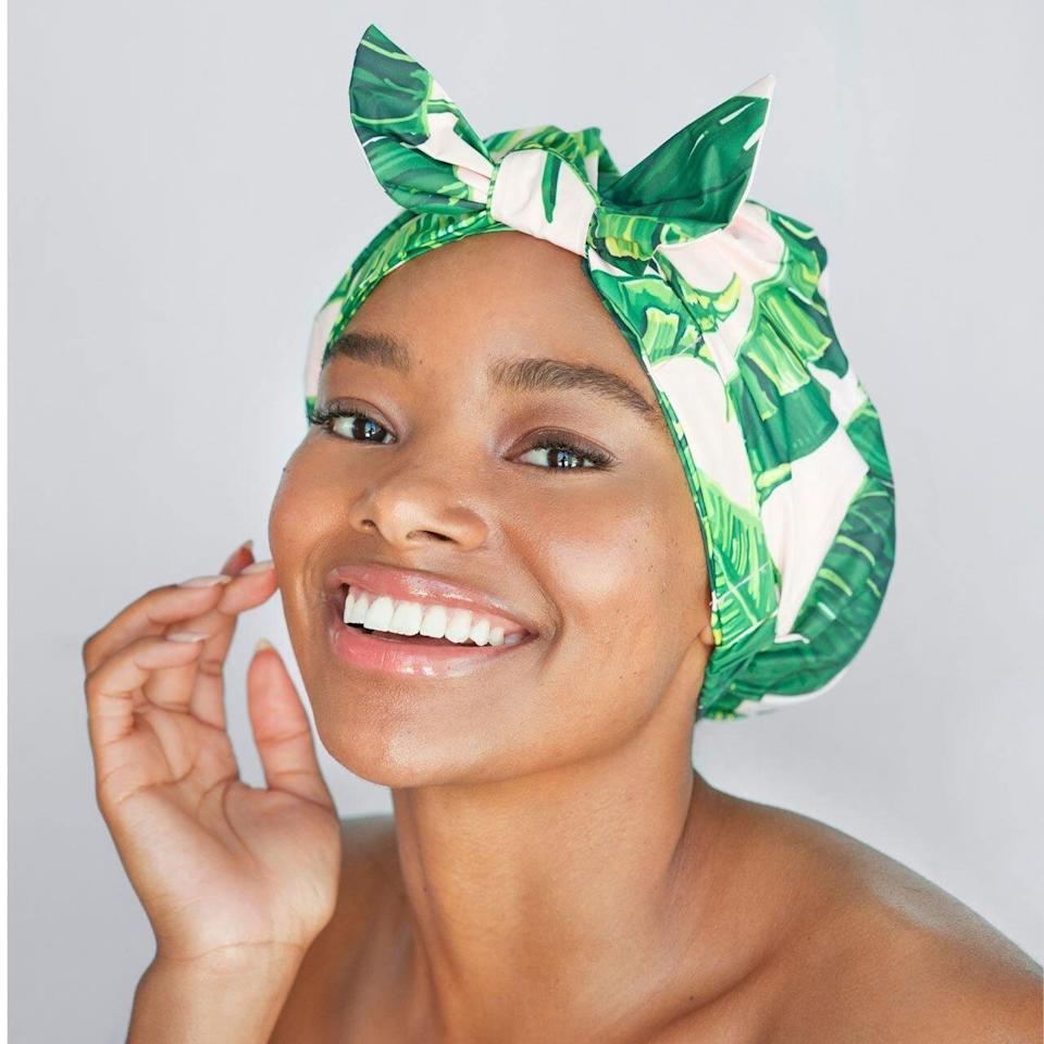 <p><span>Kitsch Luxe Palm Leaf Shower Cap</span> ($24)</p>