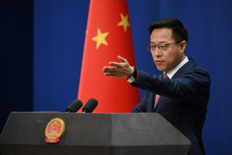 Chinese Foreign Ministry spokesman Zhao Lijian, pictured April 8, 2020, said Beijing would react to any sanctions from Washington, which has warned China over the planned security law for Hong Kong