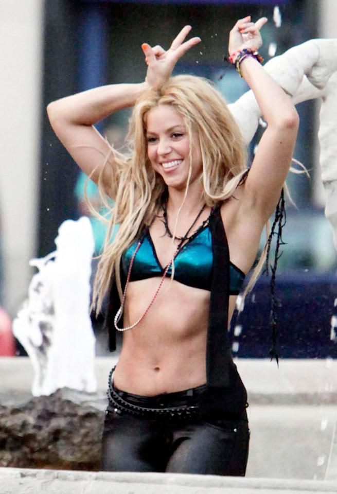 """Sporting a bikini top and skin-tight pants, Colombian songstress Shakira looked like she was having the time of her life as she splashed around in a fountain while filming her new music video in Barcelona this week. OHPIX/<a href=""""http://www.x17online.com"""" target=""""new"""">X17 Online</a> - August 17, 2010"""