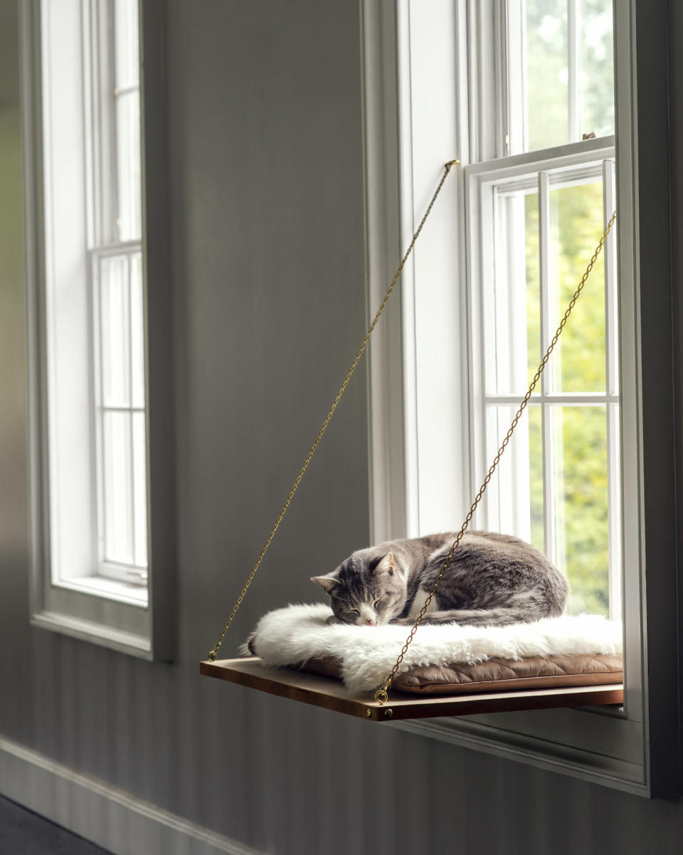 This photo provided by Martha Stewart Living shows a Cat Window Perch. Felines of all kinds will be thankful to have this cozy, custom-built napping perch, ideal for long afternoons basking in the sun. Top it off with a soft cushion or sheepskin and we bet they'll love you even more than they already do. (Michael Munday/Martha Stewart Living via AP)