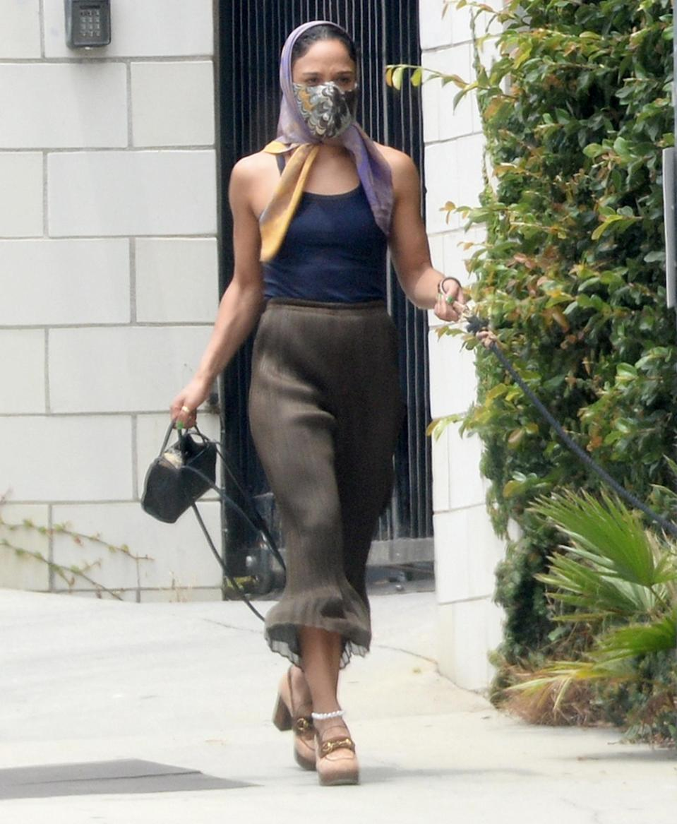<p>Tessa Thompson rocks a head scarf and mask while out in Hollywood on July 2.</p>