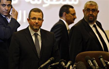 Egypt's PM Kandil is seen with Haddara, Minister of Petroleum at news conference in Cairo