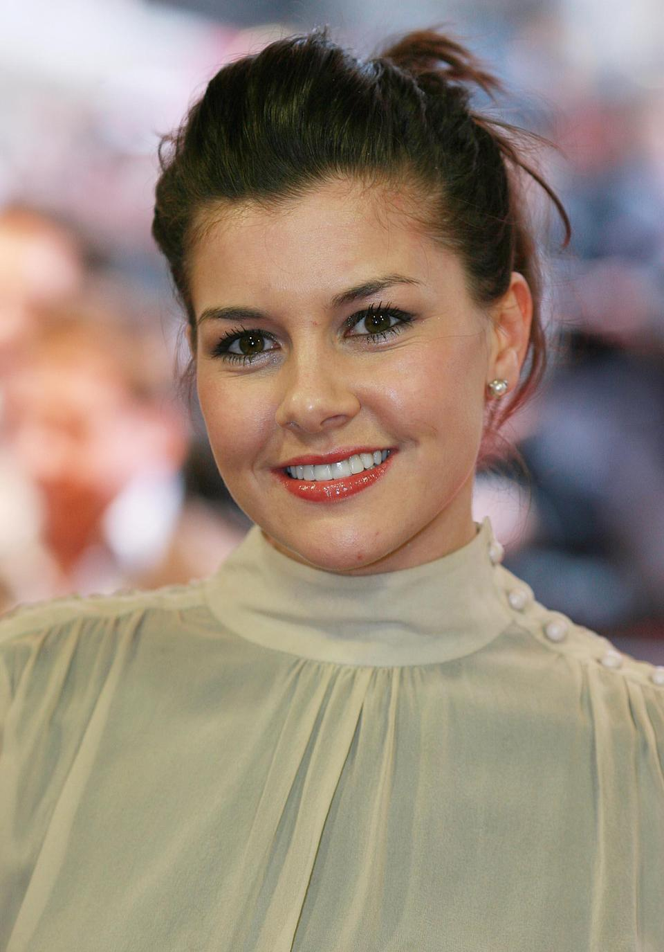Former Big Brother contestant Imogen Thomas arrives for the UK film premiere of Shooter at the Odeon West End in central London.