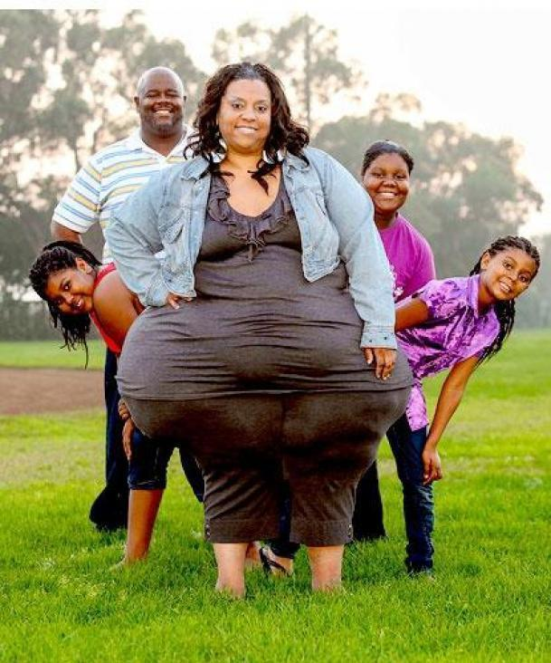 Plus-size model and part-time carer Mikel Ruffinelli, whose hips measure more than eight feet in circumference, says she has no plans to lose weight. With husband Reggie and daughters (l-r) Autumn, Destynee and Justyce.