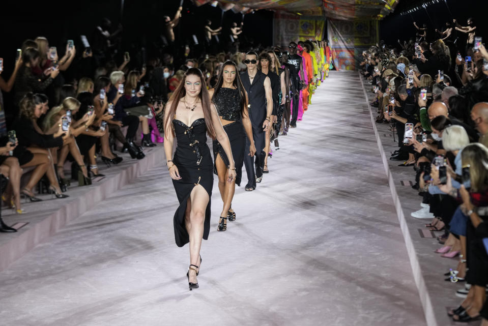 Gigi Hadid, from centre left, and Irina Shayk lead models as they wear creations for the Versace Spring Summer 2022 collection during Milan Fashion Week, in Milan, Italy, Friday, Sept. 24, 2021. (AP Photo/Luca Bruno)