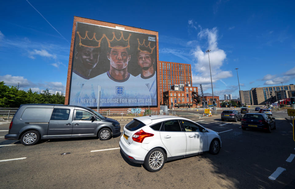 A view of a digital mural of England players, Marcus Rashford, Jadon Sancho and Bukayo Saka in Manchester, England, Wednesday July 14, 2021. The mural was unveiled on Tuesday after the three Black players missed penalty kicks in the final moments of the national soccer team's European Championship loss to Italy and received racist abuse on social media. (Peter Byrne/PA via AP)