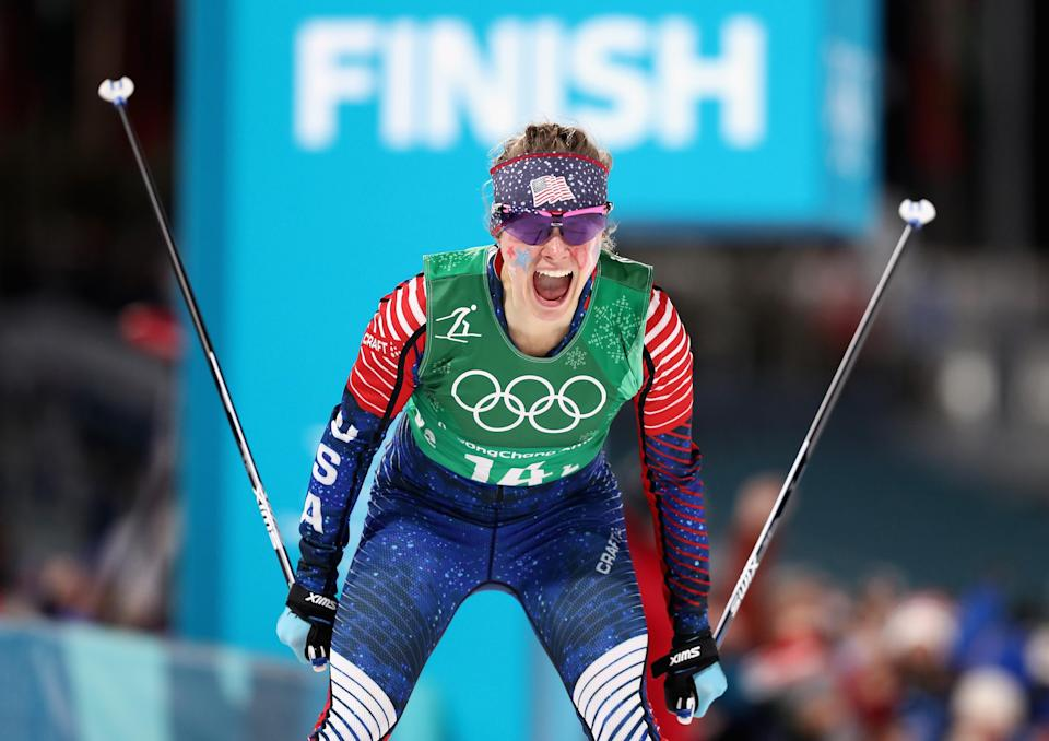 <p>Jessica Diggins of the United States celebrates as she crosses the line to win gold during the Cross Country Ladies' Team Sprint Free Final at the 2018 Winter Olympic Games in PyeongChang, South Korea on February 21, 2018.<br>(Photo by Lars Baron/Getty Images) </p>