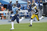 Tennessee Titans wide receiver A.J. Brown (11) runs ahead of Pittsburgh Steelers cornerback Joe Haden (23) as Brown scores a touchdown on a 73-yard pass reception in the second half of an NFL football game Sunday, Oct. 25, 2020, in Nashville, Tenn. (AP Photo/Mark Zaleski)