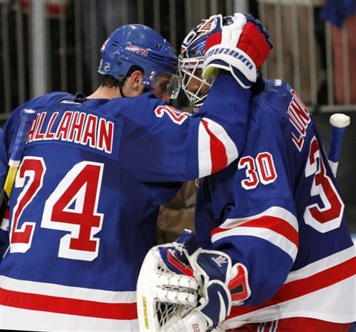 New York Rangers right wing Ryan Callahan (24) congratulates goalie Henrik Lundqvist after the Rangers shut out the New Jersey Devils 3-0 in Game 1 of their NHL hockey Stanley Cup Eastern Conference finals playoff series at New York's Madison Square Garden, Monday, May 14, 2012. (AP Photo/Kathy Willens)