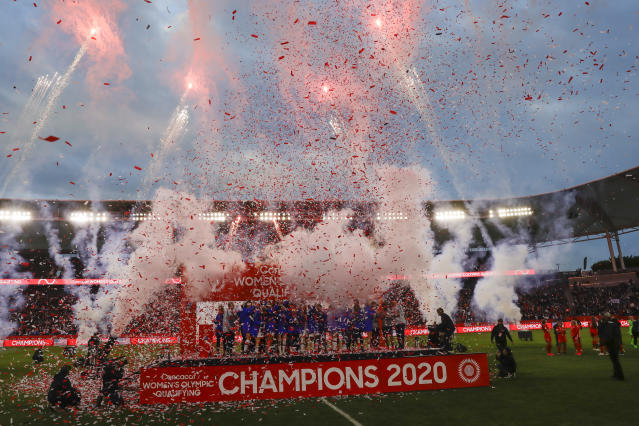 The United States team poses after winning a CONCACAF women's Olympic qualifying soccer match against Canada Sunday, Feb. 9, 2020, in Carson, Calif. The U.S. won 3-0. (AP Photo/Chris Carlson)