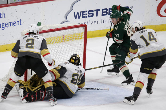 Minnesota Wild left wing Kirill Kaprizov (97) scores a goal on Vegas Golden Knights goaltender Marc-Andre Fleury (29) with Golden Knights defensemen Zach Whitecloud (2) and Nicolas Hague (14) defending during the third period during an NHL hockey game Wednesday, May 5, 2021, in St. Paul, Minn. The Golden Knights won 3-2 in overtime. (AP Photo/Andy Clayton-King)
