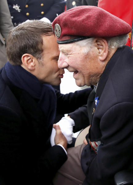 French President Emmanuel Macron greets a veteran during ceremonies marking the 74th anniversary of World War II victory in Europe, under the Arc de Triomphe Wednesday May 8, 2019 in Paris . (Christian Hartmann, Pool via AP)