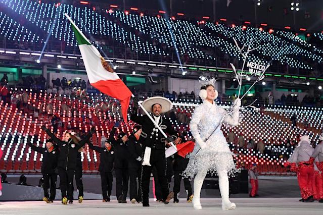 <p>Flag bearer German Madrazo of Mexico leads his country wearing a traditional sombrero and embroidered blazer and trousers while the team wears traditional all-black winter clothes during the opening ceremony of the 2018 PyeongChang Games. (Photo: Quinn Rooney/Getty Images) </p>