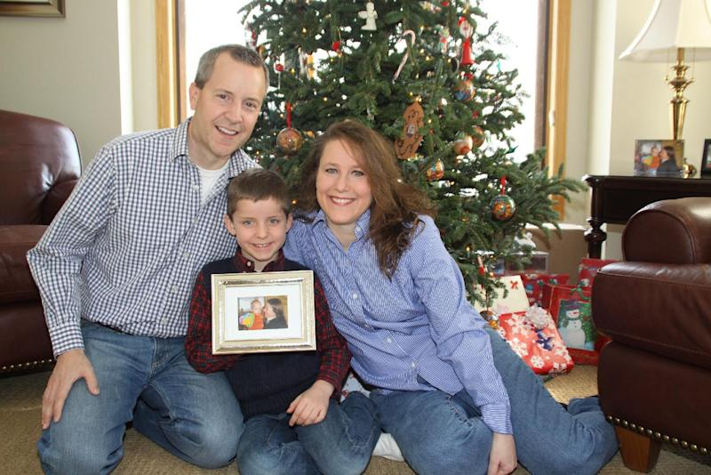 FILE - This December 2012 photo provided by the family shows, from left, John, Jack and Renee Thomas at their home in Minnetrista, Minn. Jack was adopted from Russia in 2008. On Thursday, Feb. 6, 2014, Renee went on television in Russia with an emotional appeal for an exception to be made to Russia's year-old ban on adoptions by Americans. She and her husband adopted a boy from Russia in 2008 and refuse to give up long-standing efforts to also adopt Nikolai, their son's biological brother. (AP Photo/Ron Ruud)