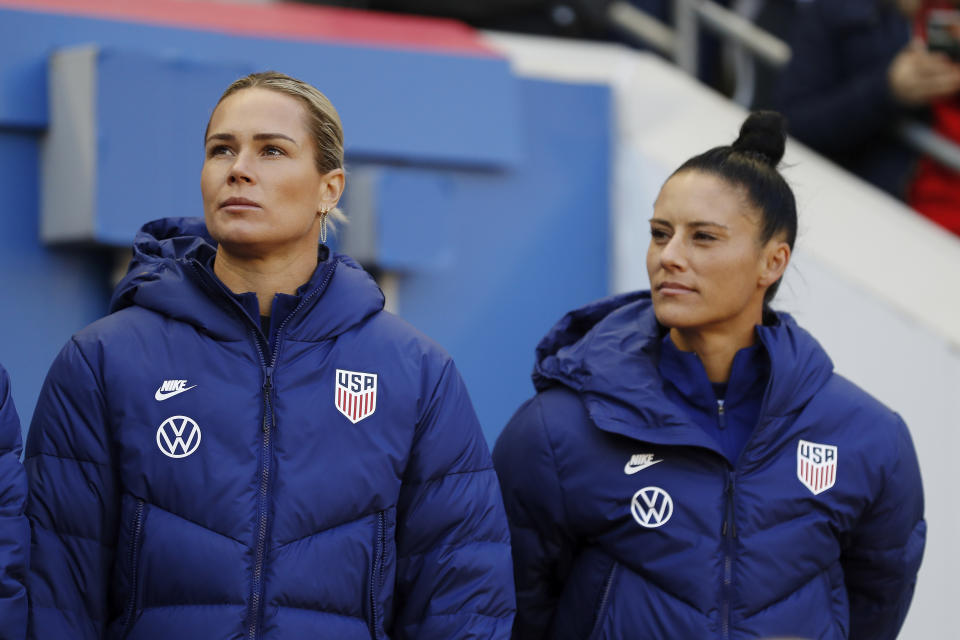 United States goalkeeper Ashlyn Harris, left, and United States defender Ali Krieger look out from the bench before the first half of a SheBelieves Cup soccer match against Spain Sunday, March 8, 2020, in Harrison, N.J. The United States won 1-0. (AP Photo/Steve Luciano)