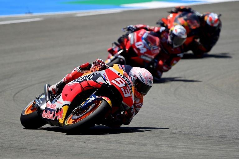 Marc Marquez (L) in action in the Spanish MotoGP before he suffered a crash and broke a bone in his right arm