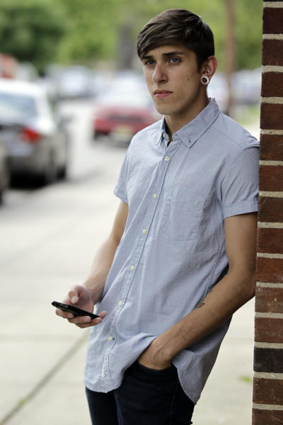 Dylan Young, 18, a senior at North Arlington High, stands Wednesday, June 6, 2012, near the site where he was in a fender bender caused by being distracted while texting and driving, in North Arlington, N.J. More than half of high school seniors say they text or email while driving, according to a jarring new study that offers the first federal statistics on how common the dangerous habit is in teens. The Centers for Disease Control and Prevention released the numbers Thursday, June 7, 2012. They come from a 2011 survey of about 15,000 high school students across the country. The study found 58 percent of high school seniors said that, in the previous month, they had texted or emailed while driving. (AP Photo/Julio Cortez)