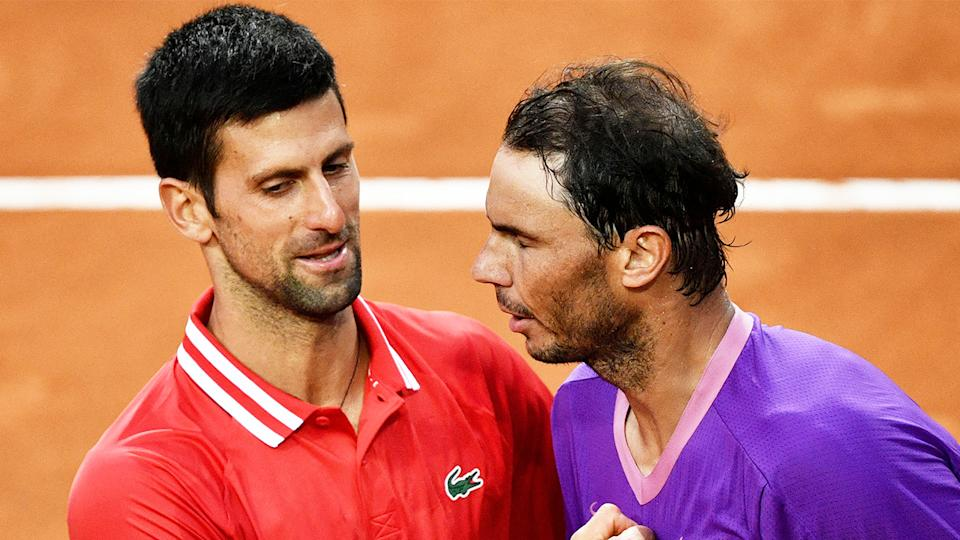 Novak Djokovic (pictured left) embracing Rafael Nadal (pictured right) after losing at the Italian Openn.